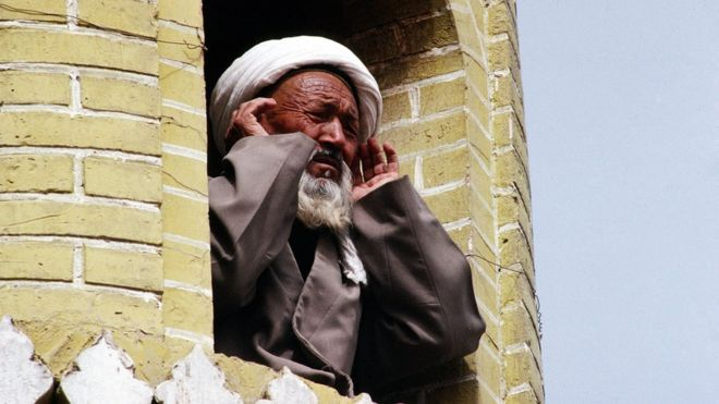 A Muslim man leads the call to prayer in China's Xinjiang region in 2008. | Getty Images (BBC)